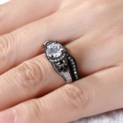 Jeulia Twist Two Tone Round Cut Sterling Silver Skull Ring